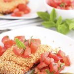 Baked salmon with sesame seeds and tomato